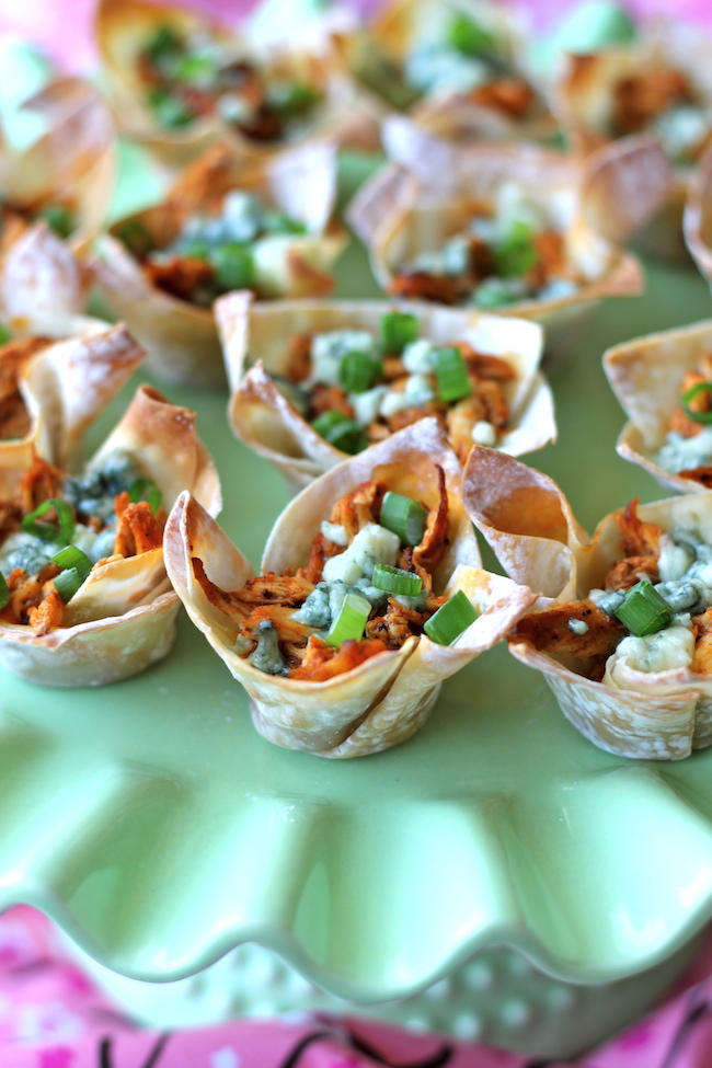Buffalo Chicken Cups - Crisp oven-baked wonton cups loaded with buffalo chicken and blue cheese!