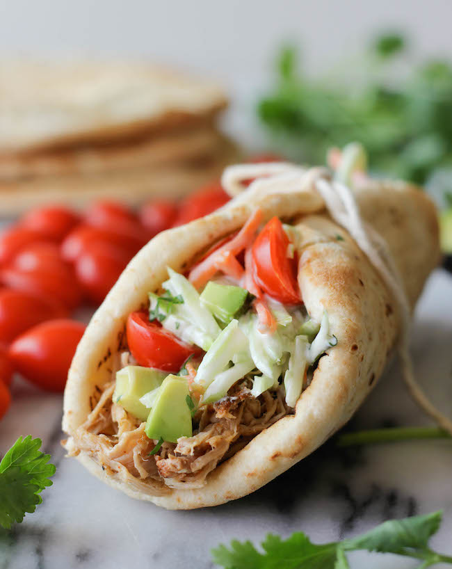 Slow Cooker Pulled Pork Gyros - It's time to dust off that crockpot with these tender pulled pork gyros!