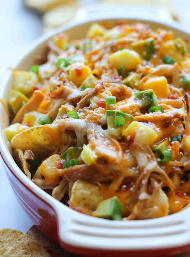 Asian Style Nachos - Loaded with leftover chicken teriyaki, fresh pineapple and spicy Sriracha, the whole family will be begging for more!
