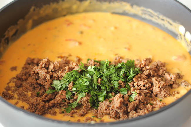 Beef Queso Dip - An incredibly velvety, meaty queso dip that is completely irresistible, and you can make it in just 15 minutes!
