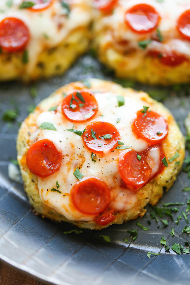 Mini Cauliflower Pizzas - These pizzas are made into easy single-serving portions and are so much healthier with a crisp cauliflower crust! 98.5 calories.
