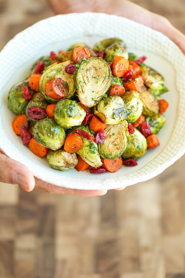 Balsamic Roasted Brussels Sprouts and Carrots - Golden brown, crisp brussels sprouts and carrots tossed in balsamic vinegar and maple syrup. Simply AMAZING!