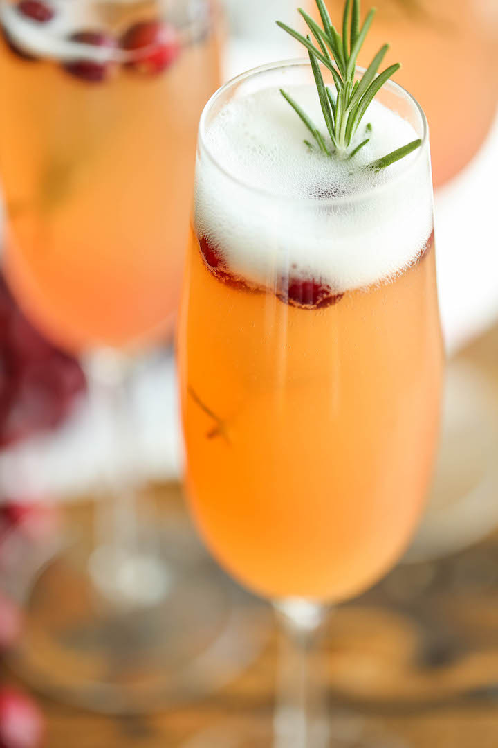 Cranberry Mimosa - The only holiday cocktail recipe you need. Just 6 ingredients (2 are garnishes) for the prettiest, easiest and elegant drink ever! Done.