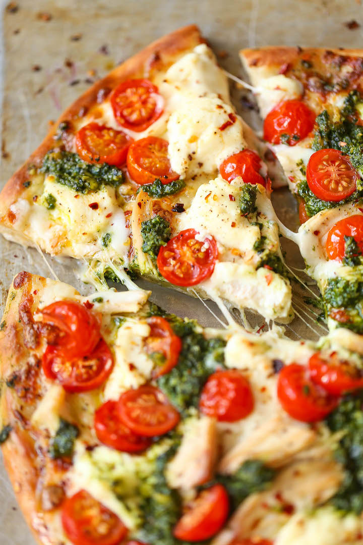 Chicken Pesto Pizza - The absolute perfect weeknight meal that comes together in minutes! Use leftover rotisserie chicken, fresh tomatoes, pesto and cheese!