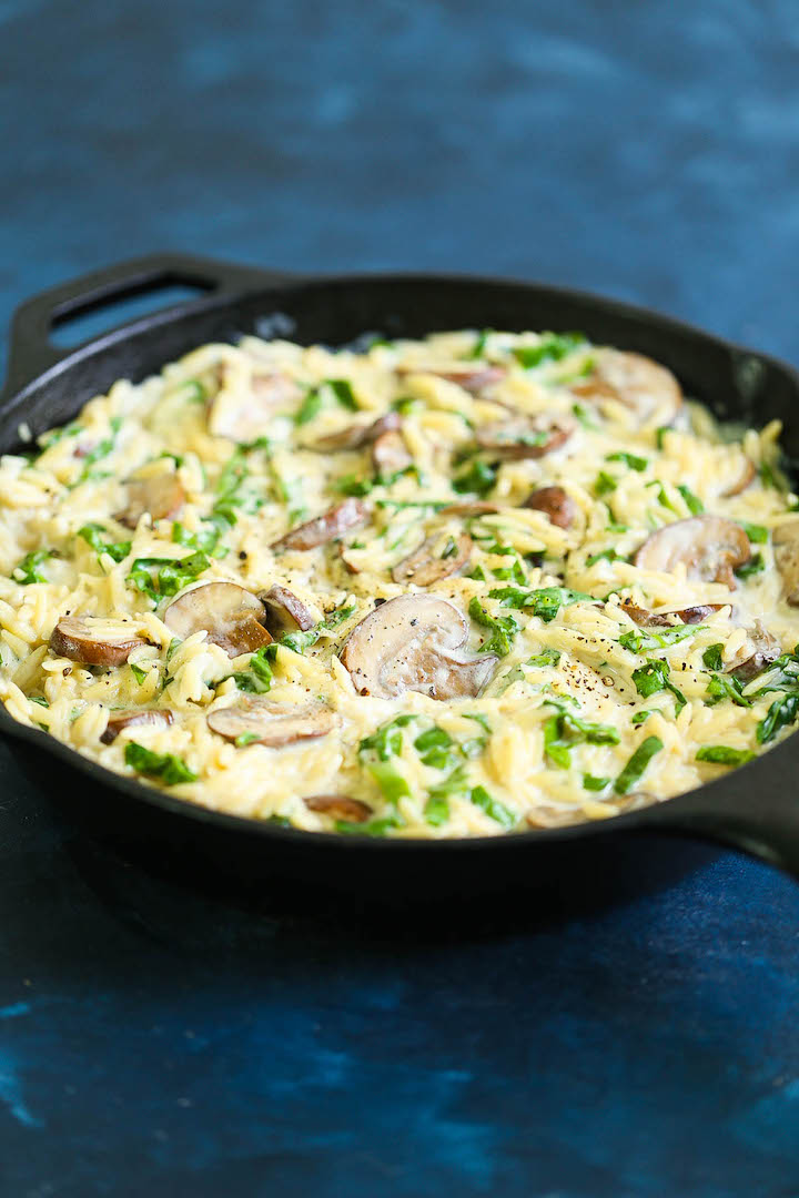 Creamy Mushroom Spinach Orzo - This creamy, hearty orzo dish makes for the best vegetarian side dish ever! Loaded with mushrooms, spinach and freshly grated Parmesan cheese for the most amazing garlic Parmesan cream sauce. You can also add chicken and turn this into a main dish!
