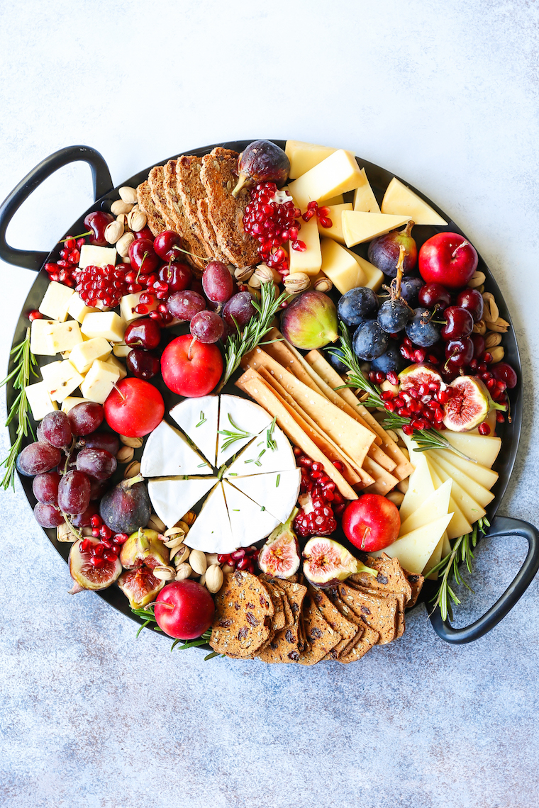 Holiday Cheese Board - The most EPIC appetizer board ever! With an assortment of cheeses, figs, nuts, and pomegranate, this is the must-have holiday recipe!