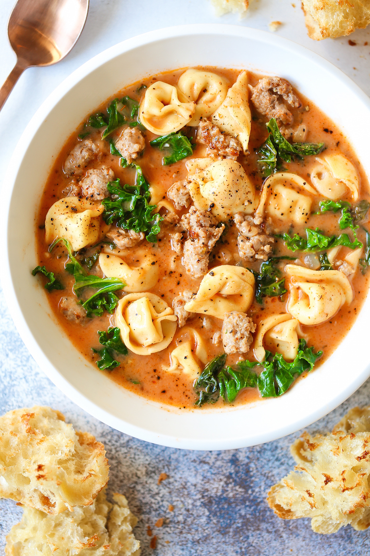 Creamy Tortellini Soup - My favorite cozy weeknight soup made in just 30 min! It's so stinking easy too. Loaded with tender tortellini, sausage and kale!