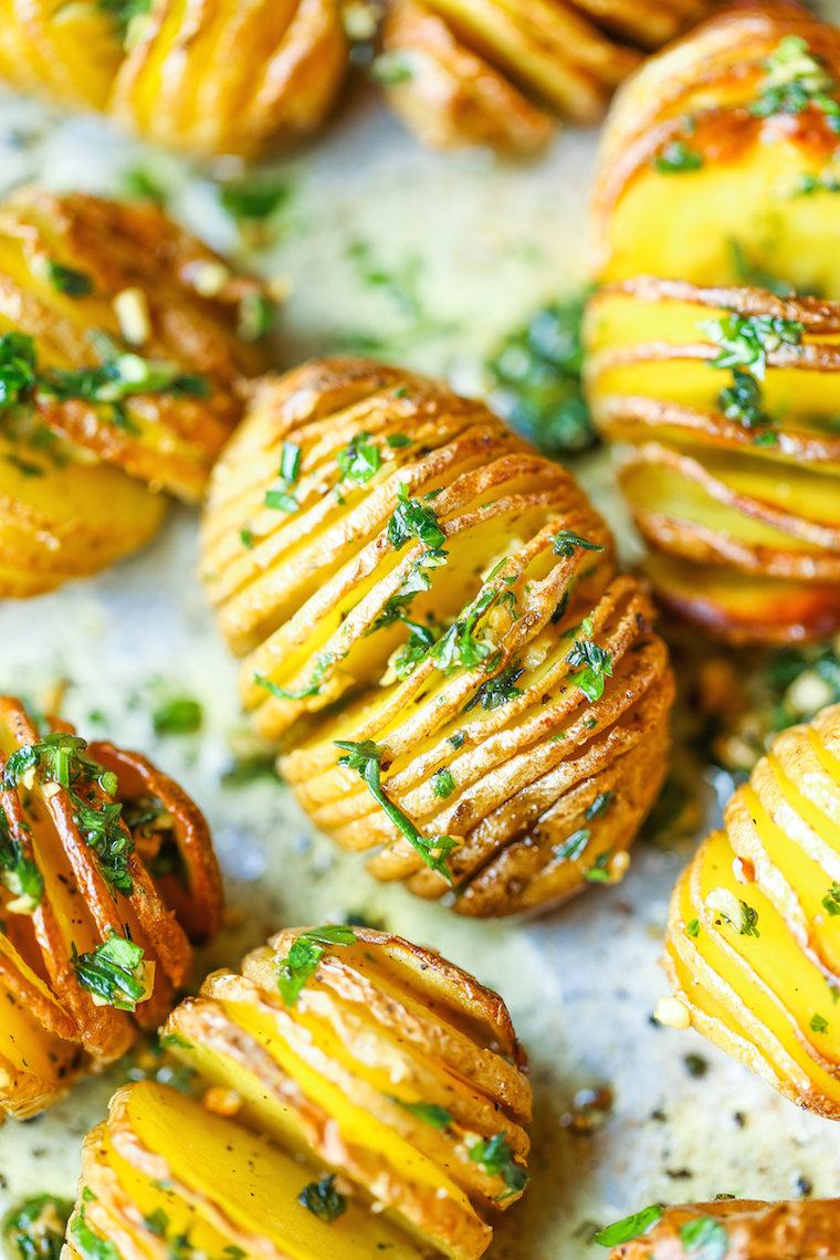 Mini Hasselback Potatoes - Crisp-tender, garlicky, herb hasselback potatoes make for the perfect side dish! And they're mini so it makes for easy serving!