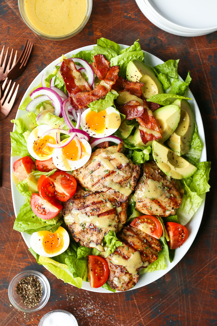 Grilled Chicken Cobb Salad - No more boring cobb salads! Made with the juiciest garlic rosemary chicken thighs and the most flavorful honey Dijon dressing!
