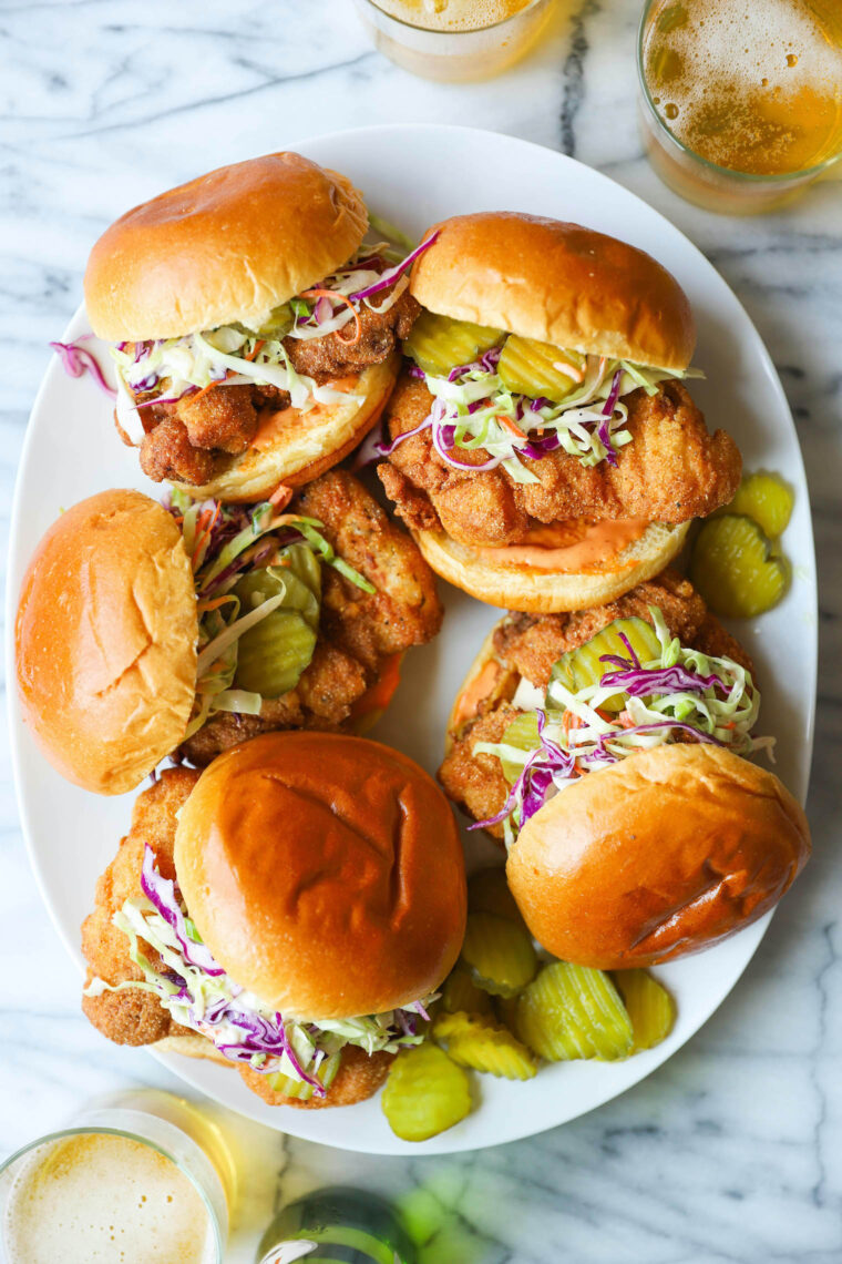 Fried Chicken Sandwiches - KILLER buttermilk fried chicken thighs! So crispy, so juicy. Served with Sriracha mayonnaise, coleslaw and pickles!