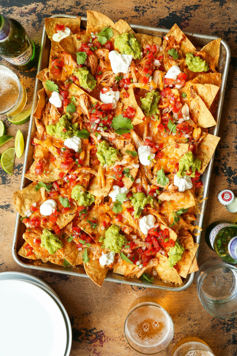 Instant Pot Chicken Nachos - Need to whip up the BEST EVER nachos for a crowd with minimal effort? THIS IS IT! Fully loaded and so so good.
